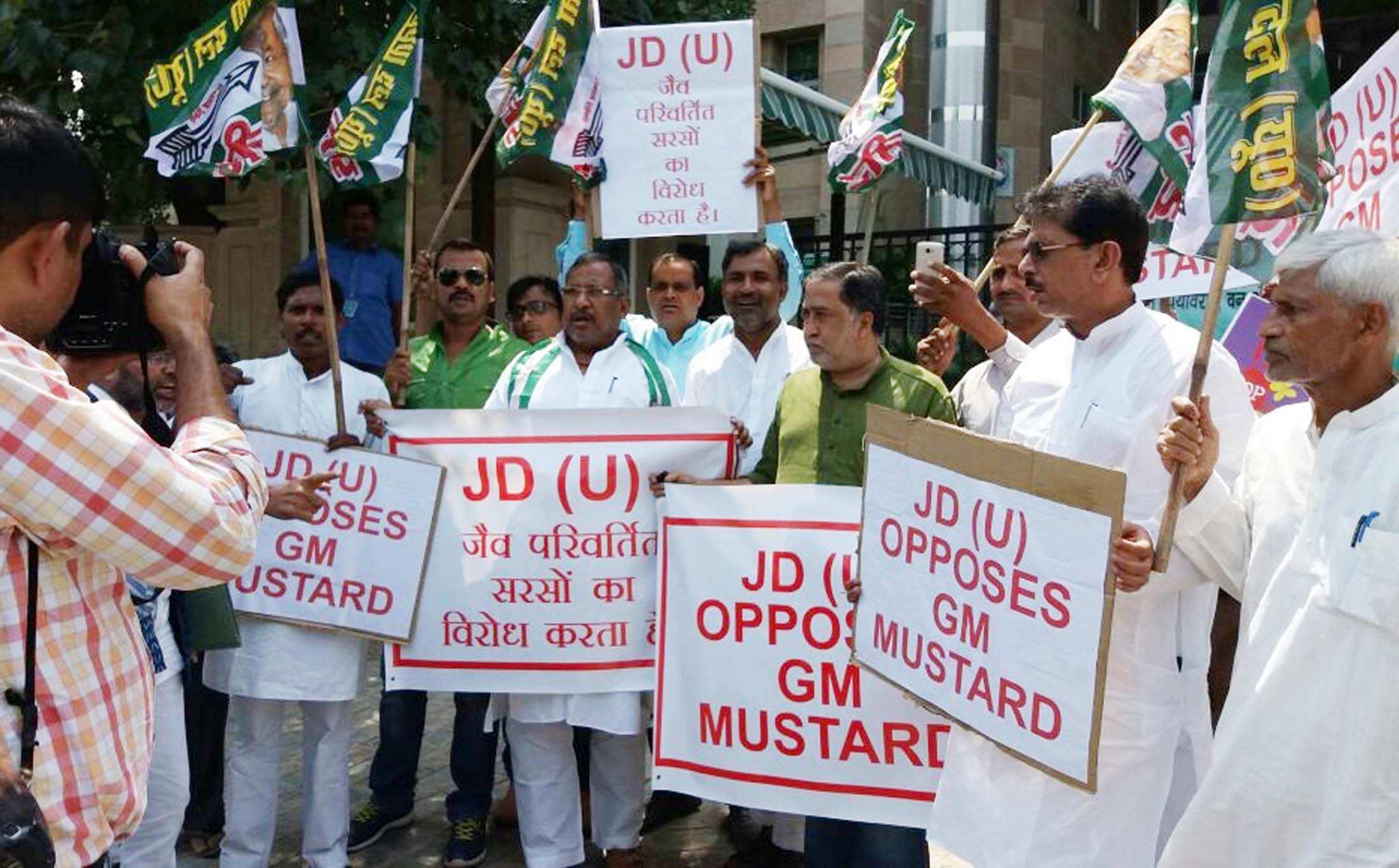JD(U) leaders demonstrate against GM mustard in New Delhi. Photo: UNI
