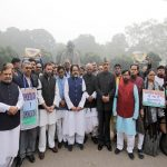 MPs of all opposition parties wearing black band holding a demonstration in front of the Gandhi statue at Parliament house in protest against the demonetisation. Photo: UNI