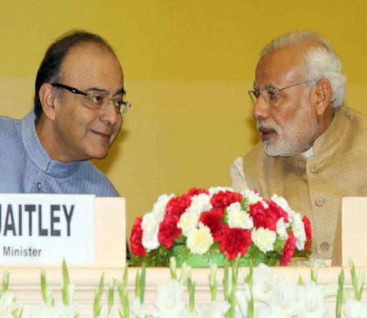 A file picture of Prime Minister Narendra Modi in conversation with Union Finance Minister Arun Jaitley (Left) during the Delhi Economics Conclave 2015, in New Delhi. Photo: UNI