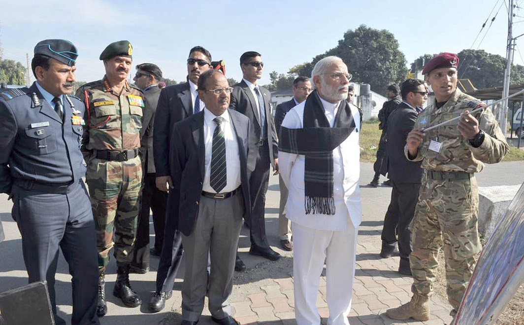Prime Minister Narendra Modi (second from right) with National Security Advisor Ajit Doval (Centre) visiting Pathankot air base after the terrorist attack at the base. Photo: UNI