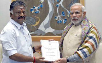 Tamil Nadu CM O Panneerselvam and PM Modi with the jallikattu ordinance in New Delhi. Photo: UNI