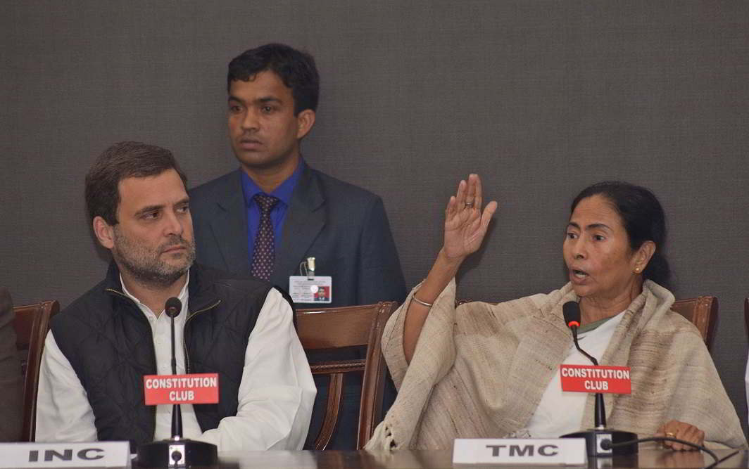 Congress vice-president Rahul Gandhi with Trinamool Congress supremo and West Bengal Chief Minister Mamata Banerjee addressing a meeting in New Delhi. Photo: UNI