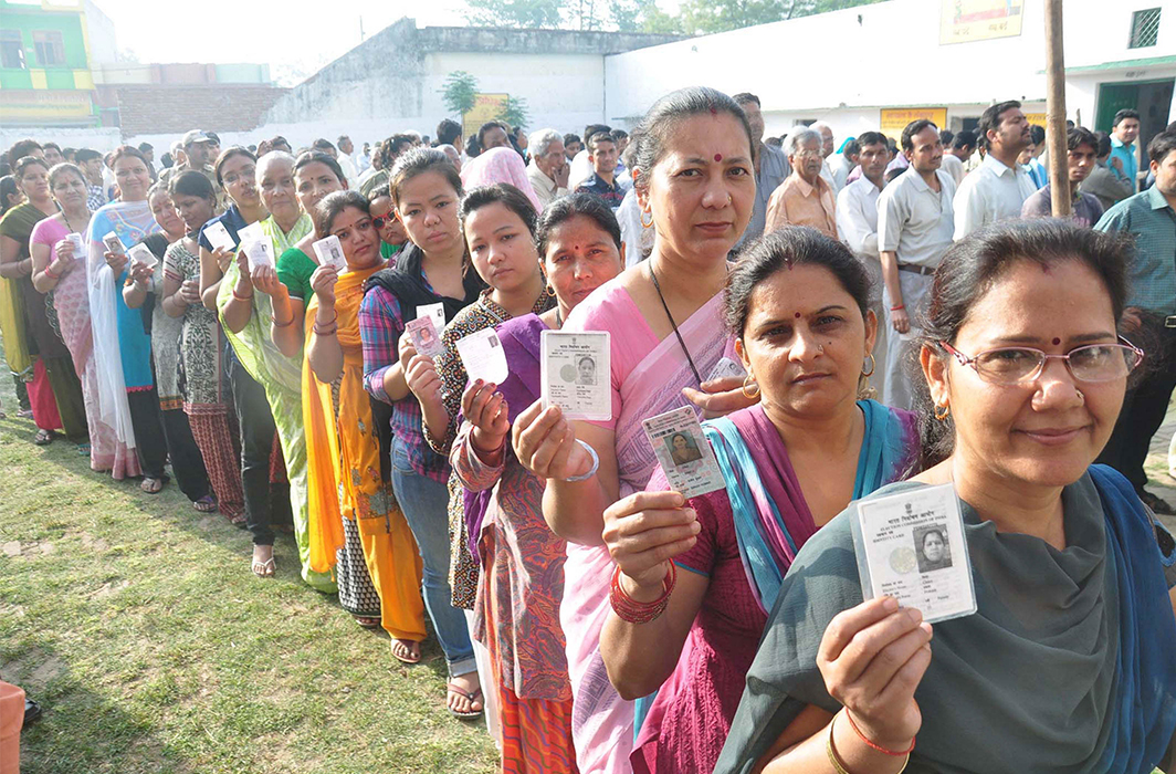 People queuing up at a polling booth in Moradabad, UP. Photo: UNI