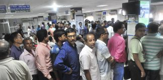 People standing in long queues to exchange their old notes at a bank in Agartala. Photo: UNI