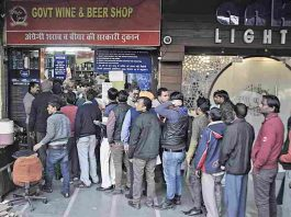 People queuing up at a liquor shop.