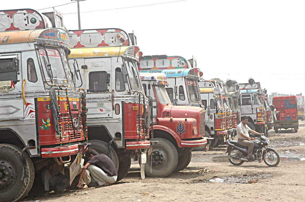 Trucks await clearance at an inter-state checkpost.