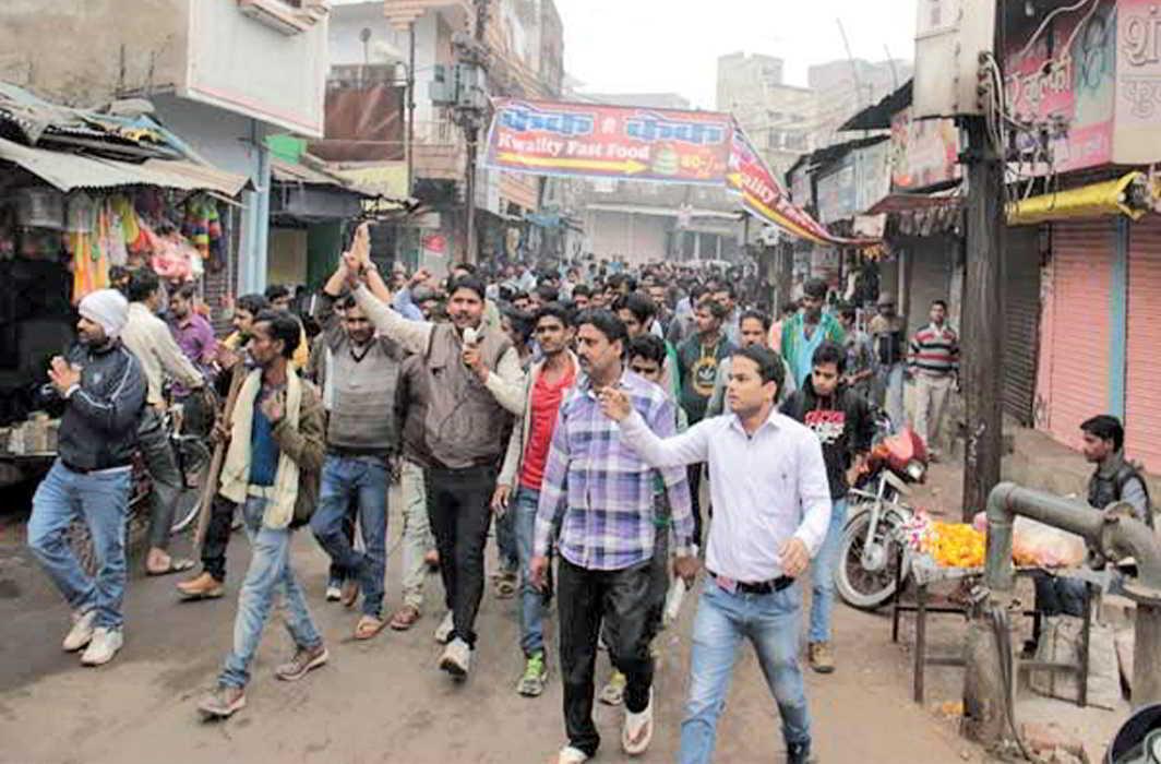 People protesting against the transfer of SP Navneet Bhasin in Bhind
