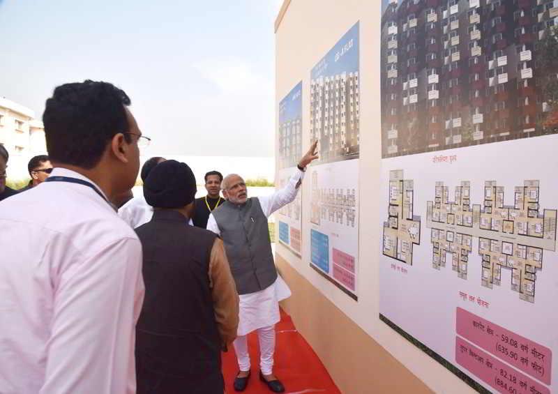 Prime Minister Narendra Modi launching the Pradhan Mantri Awas Yojana housing scheme for the poor