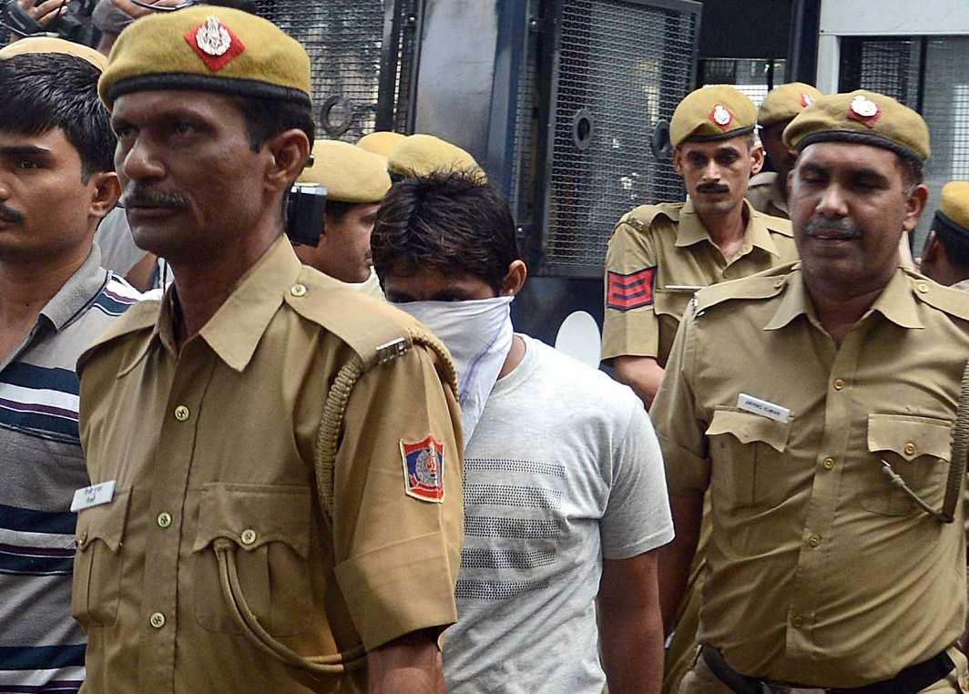 A prisoner being taken to jail. Photo: UNI