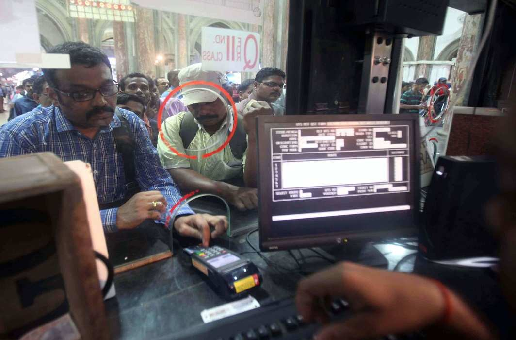 Passengers purchasing tickets at a cashless transactions counter at Mumbai railway station. Photo: UNI