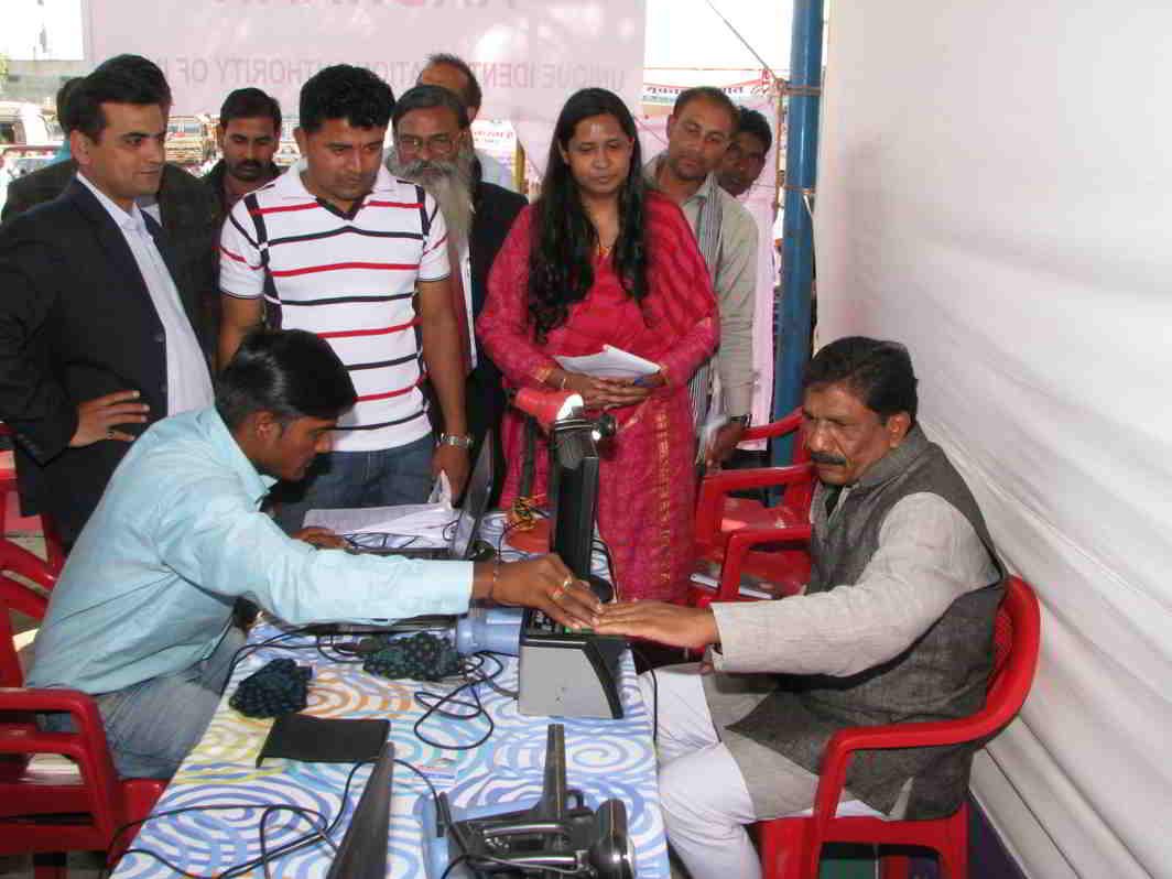 A Member of Parliament registering for his Aadhaar card at an Aadhaar registration counter. Photo: PIB