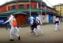A group of students clashing with security forces in Srinagar. Photo: UNI