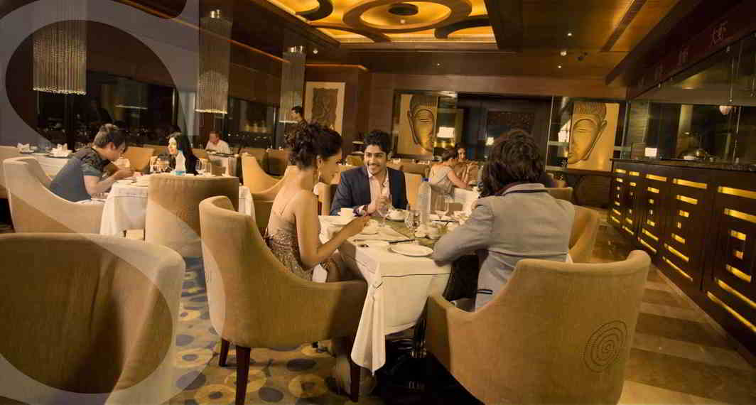 Guests at an upscale bar enjoying the luxe ambience