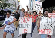 Demonstrators in Washington protesting against violence unleashed on Blacks. Photo: UNI