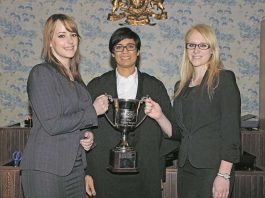 Her Honour Anuja Dhir QC (centre) with the winners of a moot court competition