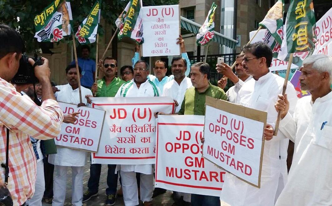 JD(U) leaders demonstrating against GM Mustard in Delhi. Photo: UNI