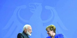Prime Minister Modi with German Chancellor Angela Merkel in Berlin. Photo: UNI