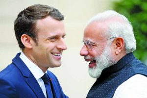 Prime Minister Modi with French President Emmanuel Macron in Paris. Photo: UNI