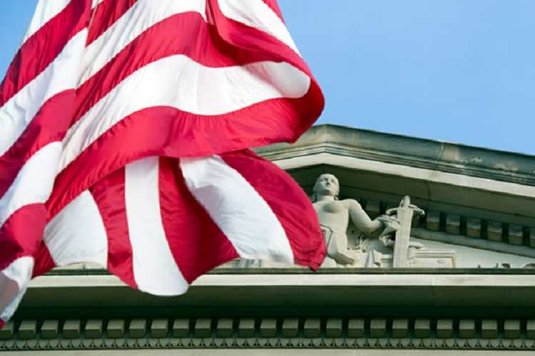 An American flag outside the Justice Department in Washington, D.C. Courtesy: ProPublica