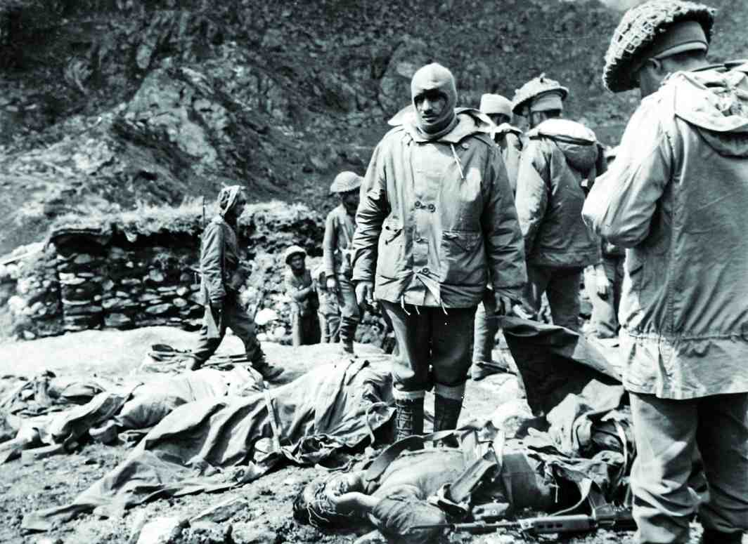 Soldiers surveying the loss and damage during the 1962 Indo-China war. Photo: defenceforumindia.com