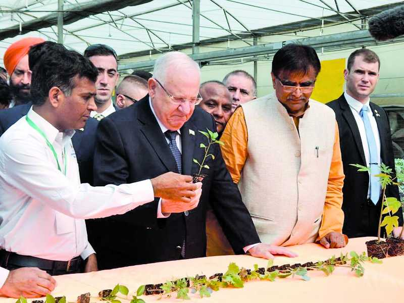 Israel's President Reuven Rivlin has a look at the training in drip irrigation technique provided to farmers at the Indo-Israel centre of excellence in Gharaunda, Karnal