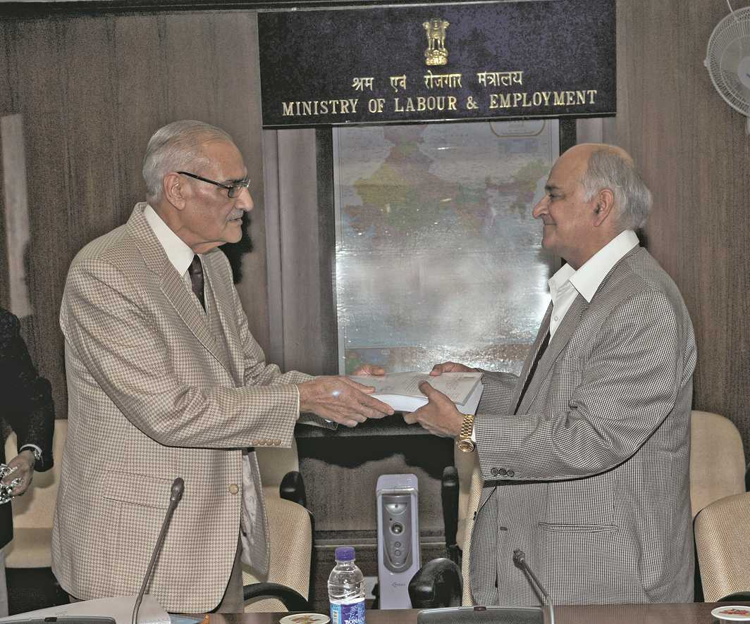 Justice GR Majithia (L) presenting the final report to PC Chaturvedi, secretary, Ministry of Labour & Employment, in 2010. Courtesy: Photo Division