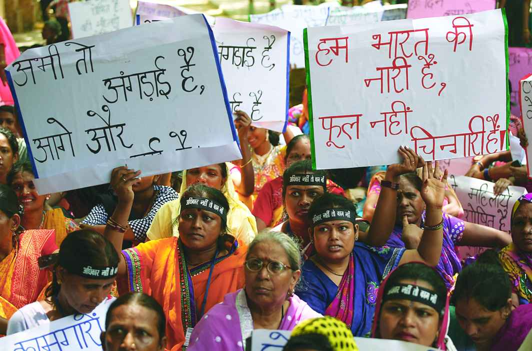Domestic workers demand a separate central legislation during a protest at Jantar Mantar in Delhi in 2014 to ensure that their work gets due recognition. Photo: Anil Shakya