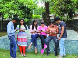 Youngsters hooked to smartphones. Photo: Bhavana Gaur