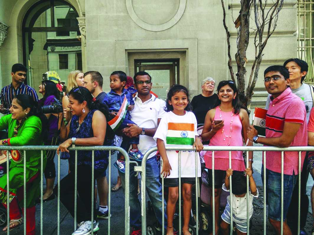 People of Indian origin watch floats go by during the India Day Parade in New York City in August 2016