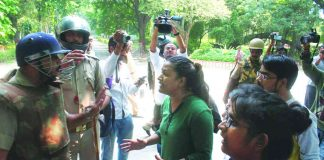 Girl students of BHU confront the police force following an incident of molestation on the campus. Photo: Getty Images