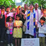 Parents and children take out a candlelight march in Delhi in search of safety and answers