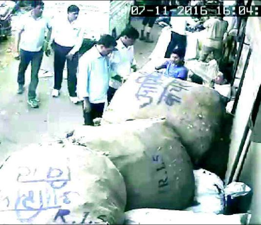CCTV footage shows Mursalin Malik and Asif Malik being questioned by five policemen outside their shop in Seelampur