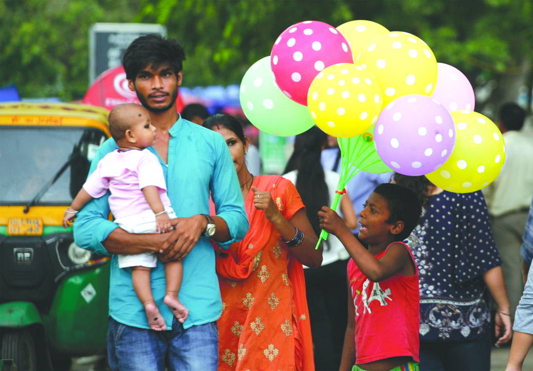 Children selling balloons and toys for a living is a common sight in Indian cities. Photo: Anil Shakya