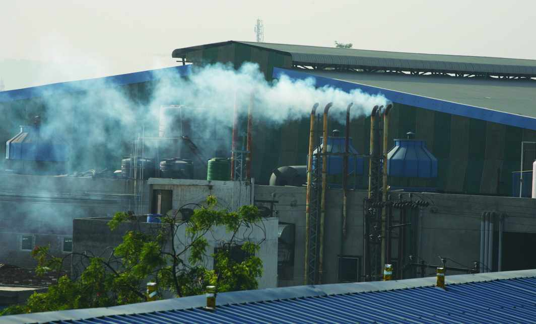 Smoke billowing out of a factory in Ghaziabad. Photo: Anil Shakya