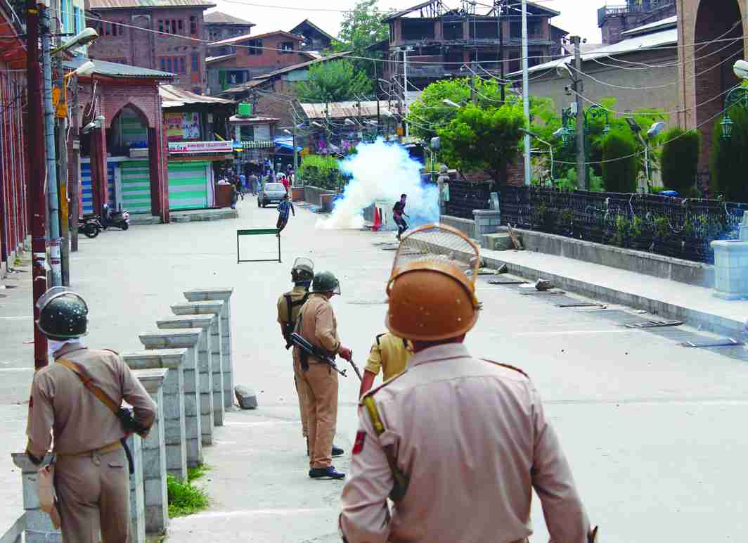 Smoke coming out from a shell fired by security personnel in Srinagar. Photo: UNI
