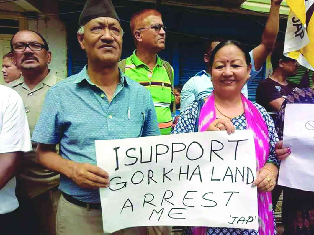 Harka Bahadur Chhetri of GJM displaying a placard demanding a separate Gorkhaland during an indefinite bandh called by the party, in Darjeeling in June. Photo: UNI