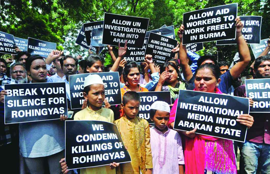 Rohingya refugees along with Indian supporters hold placards against human rights violations in Myanmar.