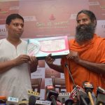 Baba Ramdev launching new Patanjali products at a press conference. Photo: UNI