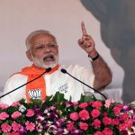 Prime Minister Narendra Modi addressing at Gujarat Gaurav Maha Sammelan in Gandhinagar (file picture). Photo: UNI