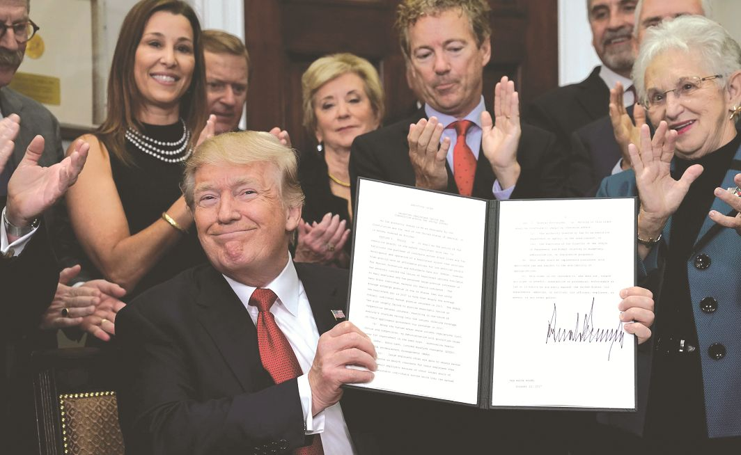 US President Donald Trump after signing an executive order to make it easier to buy bare-bone health insurance. Photo: UNI