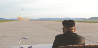 North Korean leader Kim Jong-un watches the launch of a Hwasong-12 missile. Photo: UNI