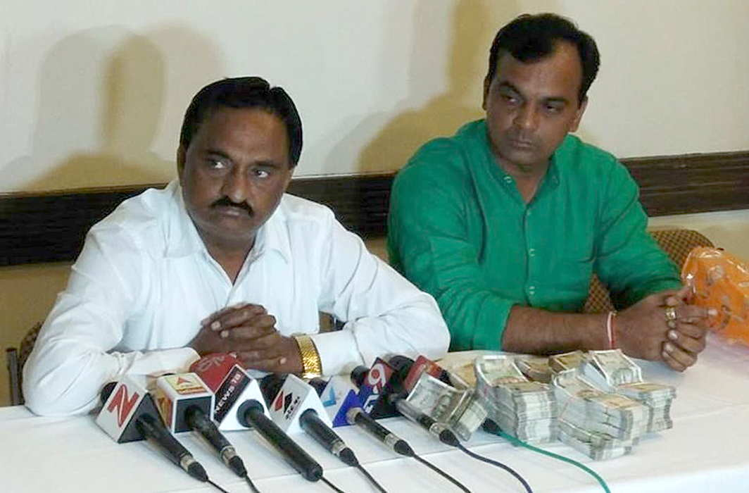 Narendra Patel (in white shirt)