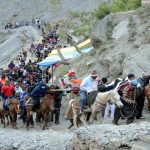 Pilgrims riding on a marshy height at Domail on Baltal-Amarnath track to have darshan of self made Ice Shivlingam in the holy cave shrine (file picture). Photo: UNI