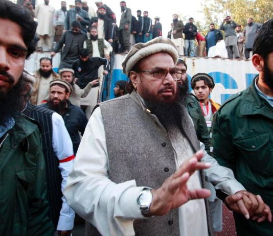 Hafiz Saeed, Lashkar-e-Taiba founder, exits after addressing his supporters during a protest against satirical French weekly newspaper Charlie Hebdo (file photo). Photo: UNI