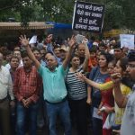 Flat buyers under the banner of Jaypee Aman Owners Welfare Association shouting slogans during a demonstration demanding for a judicial probe for delay in allotment of their pre-booked flats in New (file picture).Photo: UNI