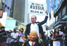 Protestors dressed as Russia's President Vladimir Putin and US President Donald Trump, in New York. Photo: UNI
