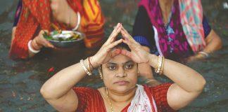A Hindu woman takes a Mahashtami dip in the Brahmaputra. Bangladeshi Hindus share roots and customs with their Indian counterparts. Photo: UNI