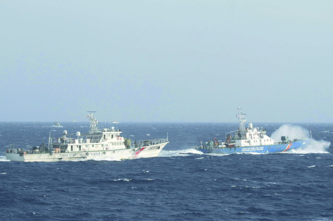 A marine guard ship from Vietnam (right in the picture) near a Chinese ship in the South China Sea. Photo: UNI