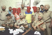 Punjab police showing weapons recovered from four members of a contract killer gang in Jalandhar. Photo: UNI