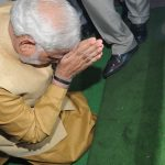 Prime Minister Modi bows down in respect at the steps of the Parliament house. Photo: UNI